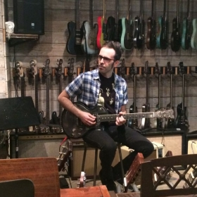 Trying out guitars at James Trussart's Workshop in Los Angeles, CA.