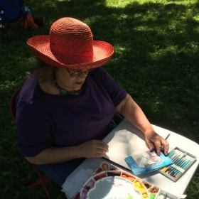 "This is a typical set-up for Jane while she is painting ""en plein air"" or in the open air----outside! Always exciting to paint outside."