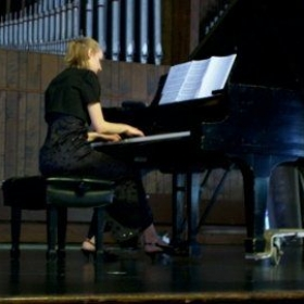 Performing in a recital.