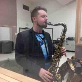 A photo of me recording some tenor saxophone at a recent session.