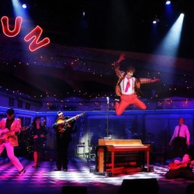 Promotional shot of me leaping off the piano at the end of Million Dollar Quartet.