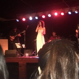 Rock student fronting the band she landed after taking voice lessons :)