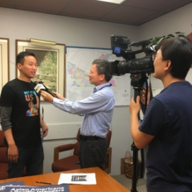 Giving an interview to a Chinese TV station