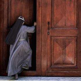 Photo of a nun walking into church. Captured in Havana, Cuba.