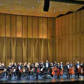 Performing in the Wilmington Symphony Orchestra.