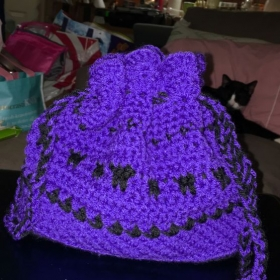 Crocheted drawstring bag.