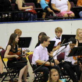 Me in a more formal orchestral setting (I'm the one front and center with his head turned)