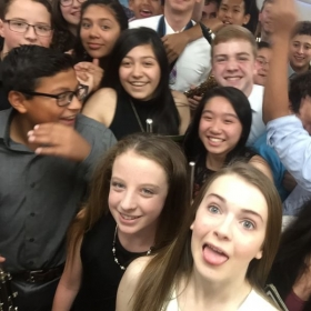 Some students taking a selfie with me before our concert.