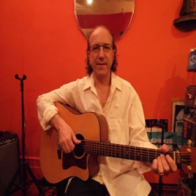 In my studio teaching and playing my trusted Guild!