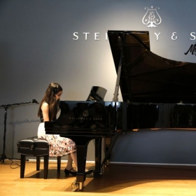 Piano student Rebecca, performing Grammy Award winning hit Hello, by Adele, off of 25
