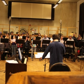 Directing a 50 strong choir in Prague for a film score.