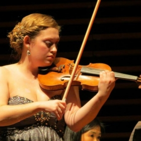 Performing for my final recital to receive my Violin Performance degree.