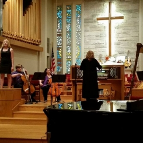 I was invited to sing with a profession harpist!
