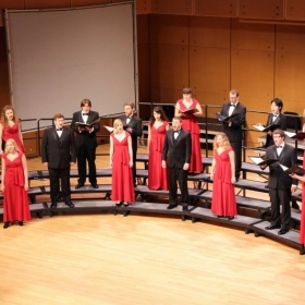 Singing at an ISU choral concert with the ISU Madrigals.