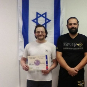 Alain Cohen in middle and I, after completing the Krav Maga Law Enforcement Course