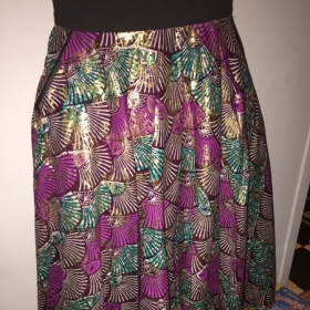 Circle skirt with leather trimmed inside pocket