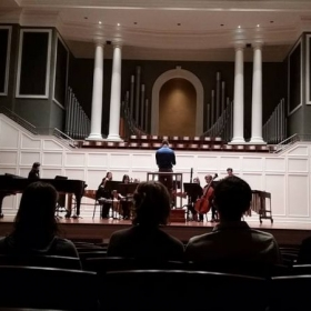 "Photo of me conducting my piece for small ensemble entitled ""Spring"" at Belmont University"