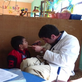 Helping with well-child-checkups in Rural Bolivia!
