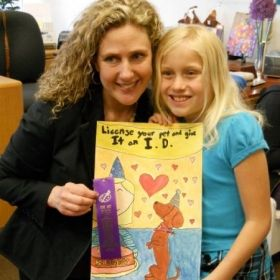 "Sascha with proud student who participated in a local art contest with her ""Birthday Daschaund"" painting."
