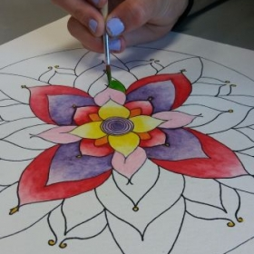 Intermediate student works on watercolor mandala while mastering brush handling and watercolors.