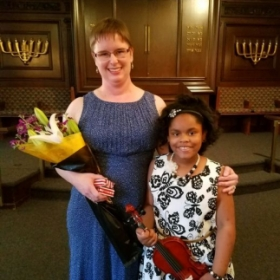 One of my violin students at the spring recital.