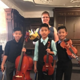 These are three brothers who take lessons from me and performed on the spring recital.