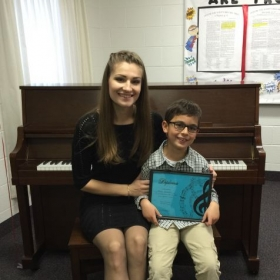 Me and one of my students after their fall recital