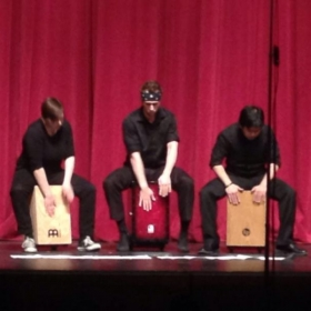 Me (Center) performing a cajon trio with my colleagues