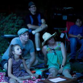 Faye's family enjoys the fun outdoor recital format while she waits to perform