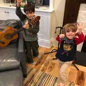 Brothers having fun AND learning a thing or two in their in-home guitar lessons!