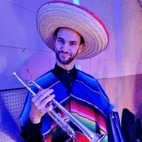 Playing the part with professional Mexican ensemble, Grupo Valle de Santiago