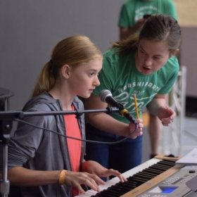 Teaching keyboarding skills at a music camp during the summer of 2017.