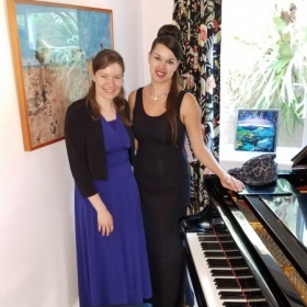 My colleague and I performing together at a private recital.
