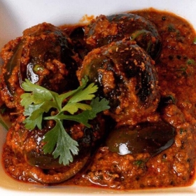 Baby eggplant in peanut curry and flavorful Indian spices from Western India