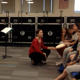 Anabelle teaching her 5th grade general music class about the djembe drum.