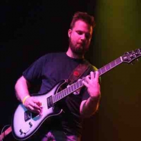 Me playing a PRS baritone guitar