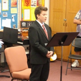My vocal student singing at a recent recital.