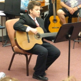 My guitar student at my last recital.