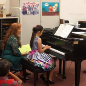My piano student and I at my last recital,