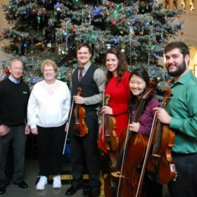Purdue University Philharmonic Quartet, after the opening ceremony performance of the Christmas Tree with University President Mitch Daniels