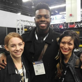 Me and fellow endorsed NS Design artist Abby Lee posing with Pentatonix singer and cellist, Kevin Olusona