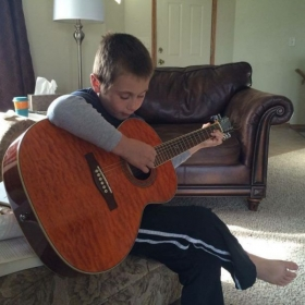 My son playing guitar at 7 years old.