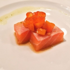 Salmon belly sashimi with ponzu marinated tomato, ikura, yuzu-kosho vinaigrette.