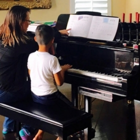Teaching on a grand piano at a student's house!