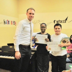 With students, Spring Showcase at Keys To Success Piano School 2017