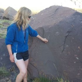 "Using a big boulder as a ""chalkboard"" for teaching in the field. :)"