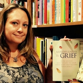 In my favorite local book store - Curious Iguana - with my book, Mindfulness & Grief.