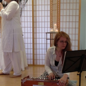 Performance for a yoga kirtan on the harmonium.