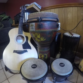 Bongos, Djembe, Talking Drum, and Taylor Acoustic Guitar.