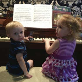 Two of my little cousins, getting used to sitting on the bench and feeling the keys!